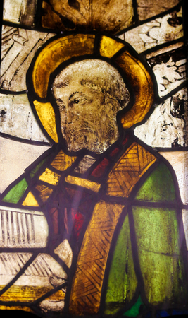 theologian: BATALHA, PORTUGAL - JULY 24, 2016: Stained Glass (15th Century) depicting a Patriarch, in the Monastery of Batalha in Portugal. Editorial