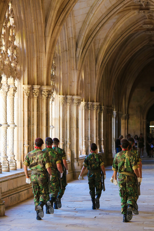 unknown age: BATALHA, PORTUGAL - JULY 24, 2016: Changing of the guard at the tombs of two unknown soldiers killed in World War I in the Chapterhouse of the Monastery of Batalha, Portugal.