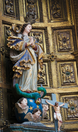 devote: AVEIRO, PORTUGAL - JULY 28, 2016: Statue of Mother Mary, Altarpiece in the Cathedral of Aveiro, Centro region, Portugal.