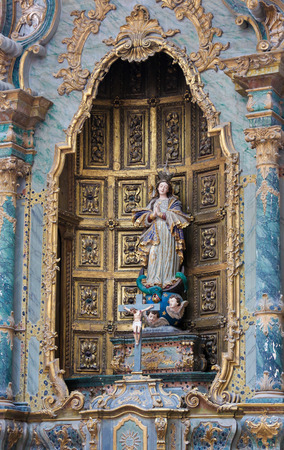altarpiece: AVEIRO, PORTUGAL - JULY 28, 2016: Statue of Mother Mary, baroque altarpiece in the Cathedral of Aveiro, Centro region, Portugal.