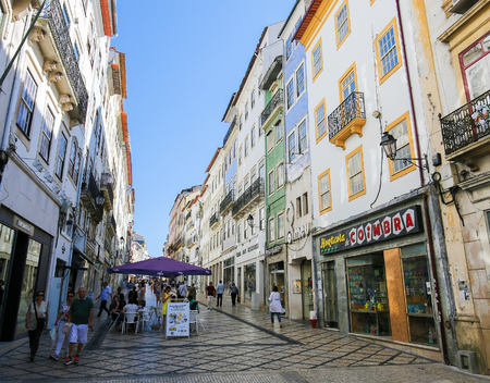Shopping street with historic houses in the center of Coimbra, Centro region, Portugal.