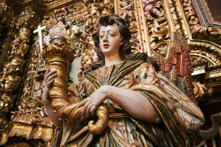 altarpiece: Detail of a gilt wood altarpiece (17th century) in the New Cathedral or Se Nova of Coimbra in Portugal Editorial