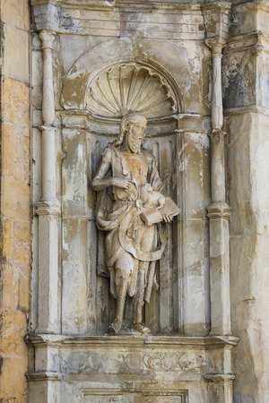 johannes: Statue of Saint John the Baptist in a niche of the front facade of the Old Cathedral in Coimbra, Portugal