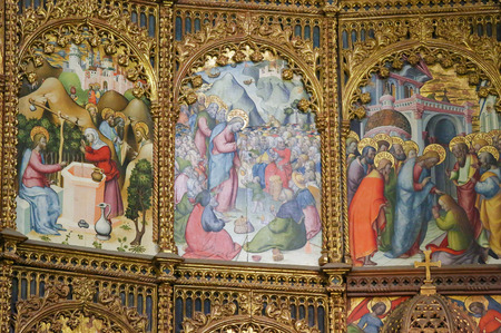 martha: Jesus and the Samaritan woman at the well, the miracle of the Feeding of the 5000 and Saint Martha. Retable in the Old Cathedral of Salamanca, Spain.