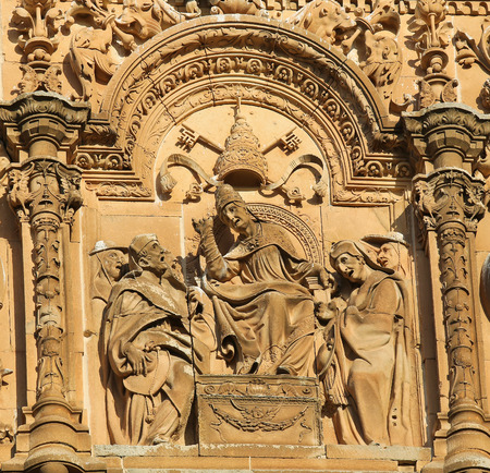 plateresque: Bas relief of the Pope and Two Cardinals on the Plateresque facade of the University of Salamanca, Spain. Stock Photo