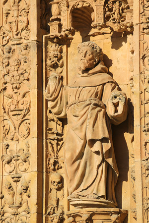 plateresque: Statue of a catholic Saint at the facade of the Convento of San Esteban in Salamanca, Spain