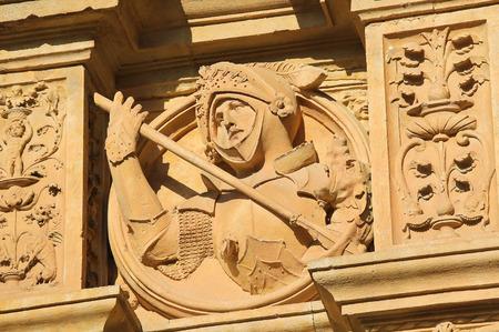 reredos: Bas relief of a medieval Knight in armor, on the facade of the Convento de San Esteban, a Dominican monastery in Salamanca, Spain. Stock Photo