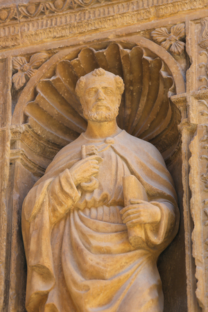 keys to heaven: Statue of the Apostle Saint Peter at the 16th Century Principal Gate at the Church of Santo Tomas in Haro, La Rioja, Spain Stock Photo