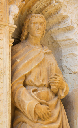 plateresque: Statue of Saint John the Apostle, depicted with a chalice and a snake, part of the 16th Century Principal Gate at the Church of Santo Tomas in Haro, La Rioja, Spain