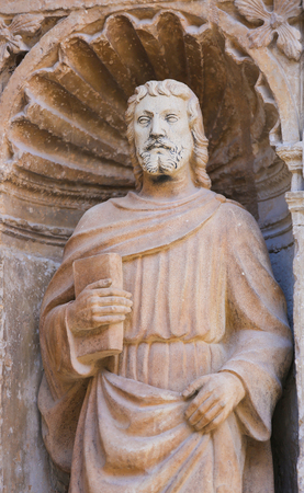 16th Century Statue of Saint Matthew the Evangelist at the Principal Gate of the Church of Santo Tomas in Haro, La Rioja, Spain Stock Photo