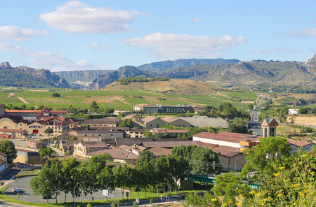 View on the famous bodegas or wine houses and vineyards of the Rioja Alta wine region near Haro, La Rioja, Spain
