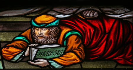 heretic: Stained Glass window depicting a heretic, in the Cathedral of Saint Rumbold in Mechelen, Belgium.