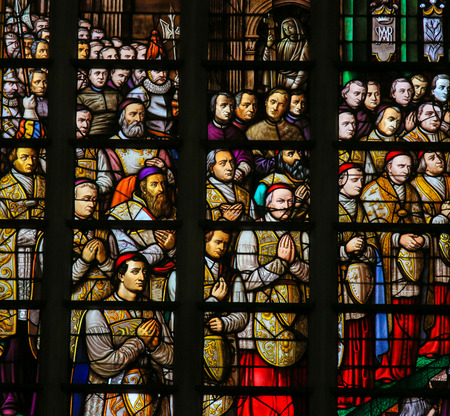 dogma: Stained Glass in Mechelen Cathedral of the promulgation of the papal bull Ineffabilis Deus, defining the dogma of the Immaculate Conception, by Pope Pius IX in 1854.