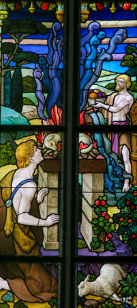 sacrificio: Stained Glass window depicting a sacrifice of lambs in the Cathedral of St Rumbold of Mechelen, Belgium.