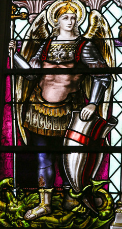 Stained Glass window depicting  the Archangel Saint Michael, in the Cathedral of Saint Rumbold in Mechelen, Belgium.