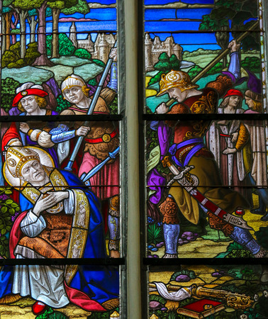 Stained Glass window depicting the Martyrdom of Saint Rumbold, patron saint of Mechelen, in the Cathedral of Saint Rumbold in Mechelen, Belgium.