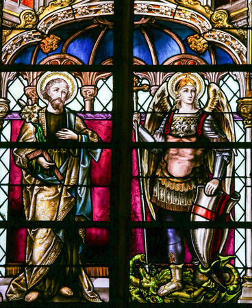 Stained Glass window depicting Saint Joseph and the Archangel Saint Michael, in the Cathedral of Saint Rumbold in Mechelen, Belgium.