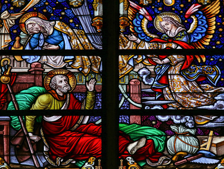 foretelling: Stained Glass window depicting the Dream of Saint Joseph, in the Cathedral of Saint Rumboldt in Mechelen, Belgium. Editorial