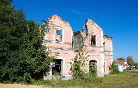 Abandoned house riddled with bullet holes during the Siege of Vukovar, on the shore of the River Danube in Slavonia, Croatia. Stock Photo