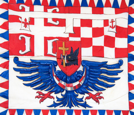 depictions: Tricolour flag in Belgrade, Serbia, with depictions of a pig, a cross and an eagle.