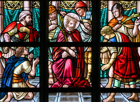 Stained Glass window depicting the Torture of Jesus on Good Friday in the Church of Alsemberg, Belgium. Editorial