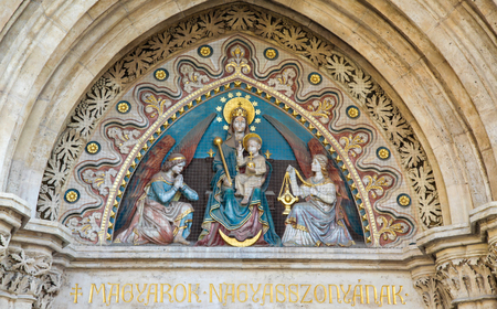 castle district: Sculpture of Mother Mary and the Infant Jesus and Two Angels at Matthias Church, a Roman Catholic church located in Budapest, Hungary, at the heart of Budas Castle District