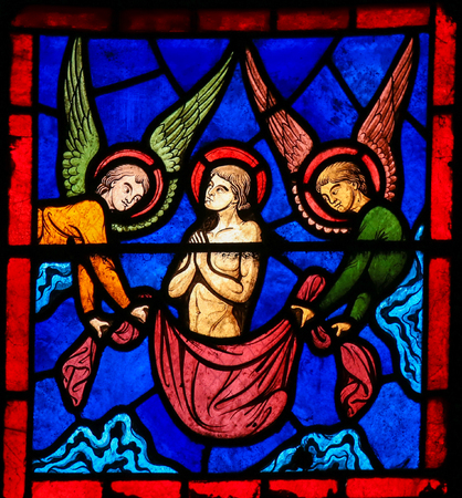 ascent: Stained Glass window in the Cathedral of Caen, Normandy, France, depicting the Ascent of Saint Stephen to Heaven, accompanied by two Angels