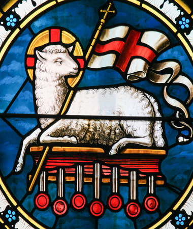 Agnus Dei. Stained Glass of a lamb holding a Christian banner, symbol for Lamb of God.