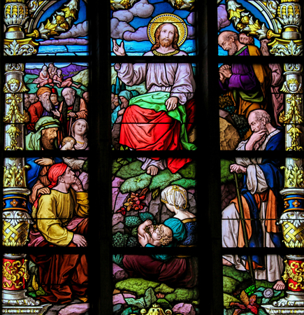 the sermon: Stained glass window depicting the Sermon on the Mount by Christ, in Saint Jamess Church in Stockholm, Sweden.