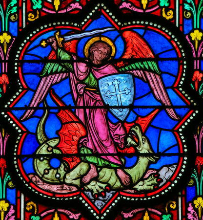 slaying: Stained Glass window in the Cathedral of Bayeux, France, depicting the Archangel Michael slaying Satan, a Dragon.