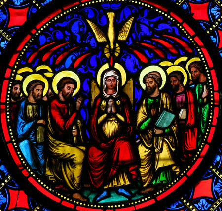 Stained Glass window in the Cathedral of Bayeux, France, depicting Mother Mary and the Apostles at Pentecost Editorial