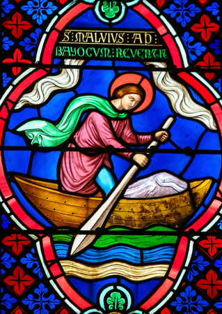 paddles: Stained Glass window in the Cathedral of Bayeux, France, depicting Saint Manveus or Manvieu, 5th century bishop of Bayeux, in a rowing boat returning from England. Editorial