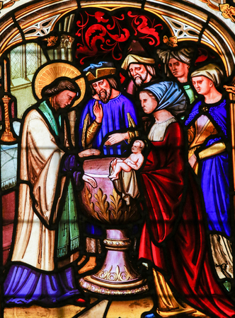 baptizing: Stained Glass window in the Cathedral of Bayeux, France, depicting Saint Vigor (died circa 537 AD), a French bishop and Christian missionary, baptizing a Child. Editorial