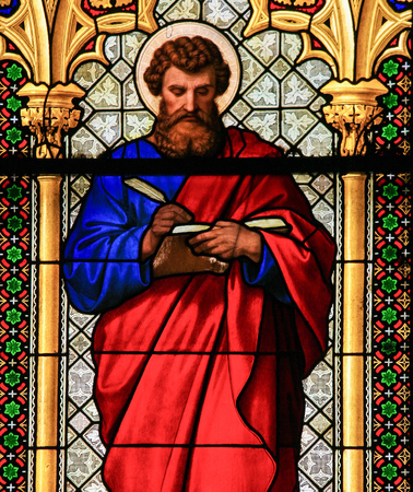 Stained Glass (1865) in the Dom of Cologne, Germany, depicting Saint Mark the Evangelist. Editorial