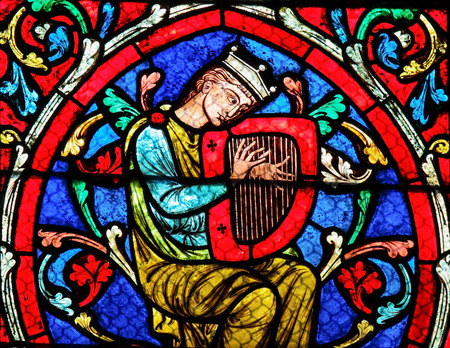 Stained glass window in the Notre Dame Cathedral in Paris, depicting King David playing on his Harp.
