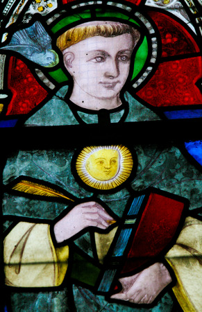 theologian: Stained Glass window in the Church of Braine-le-Chateau, Wallonia, Belgium, depicting Saint Thomas Aquinas