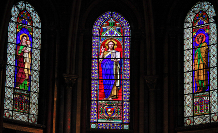 Stained Glass in Church of Saint-Germain-des-Pres in Paris, depicting Mother Mary, Jesus and Saint John the Baptist Editorial
