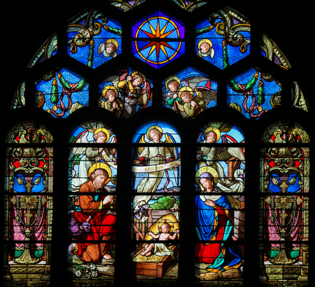 Stained Glass in Sainte Eustache Church in Paris, France, depicting a Nativity Scene at Christmas 에디토리얼