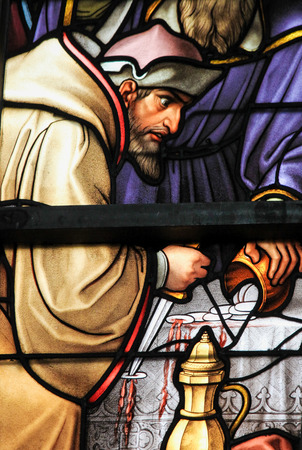 sacramental: Stained Glass depicting the local legend of a Jew desecrating sacramental bread, in the Cathedral of Brussels, Belgium. This antisemitic legend dates back to 1370.