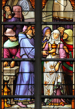 desecrated: Stained Glass depicting the antisemitic legend of desecrated sacramental bread, whereby a female Jewish convert to christianity is paid to take stolen hosts to Cologne. Editorial