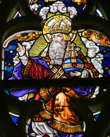 gent: Stained Glass window depicting God in Heaven, in the Cathedral of Saint Bavo in Ghent, Flanders, Belgium.