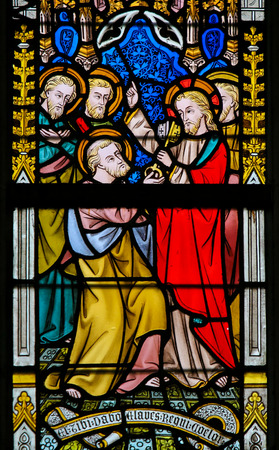 Stained Glass window depicting Jesus giving the Keys to Heaven to Saint Peter, in the Cathedral of Saint Bavo in Ghent, Flanders, Belgium.