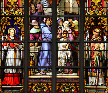 sacramental: Stained Glass depicting the antisemitic legend of desecrated sacramental bread, whereby a female Jewish convert to christianity is paid to take stolen hosts to Cologne. Editorial