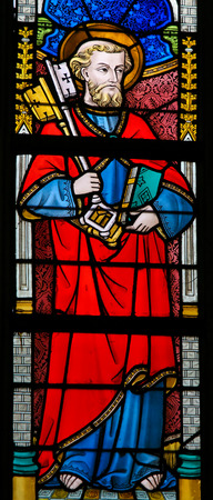 keys to heaven: GHENT, BELGIUM - DECEMBER 23, 2016: Stained Glass window depicting Saint Peter, in the Cathedral of Saint Bavo in Ghent, Flanders, Belgium.