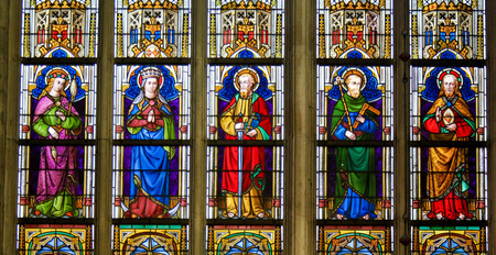Stained Glass window depicting Catholic Saints in the Cathedral of Saint Bavo in Ghent, Flanders, Belgium.