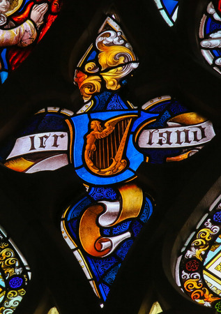 Stained Glass depicting a Celtic Harp as symbol of Ireland in the Cathedral of Saint Bavo in Ghent, Belgium.