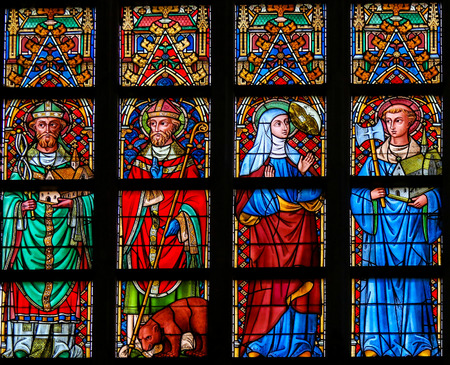 multiple stains: Stained Glass window depicting Catholic Saints in the Cathedral of Saint Bavo in Ghent, Flanders, Belgium.