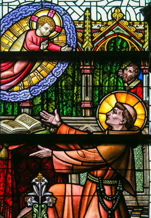 infant jesus: Stained Glass window depicting Saint Anthony of Padua and the Infant Jesus in the Cathedral of Saint Bavo in Ghent, Flanders, Belgium.