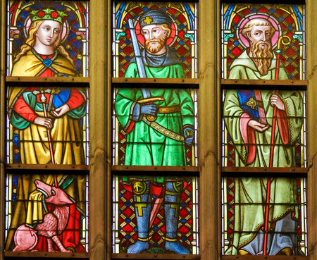 Stained Glass window depicting Saints Margaret, Hermes and Hildebert in the Cathedral of Saint Bavo in Ghent, Flanders, Belgium.
