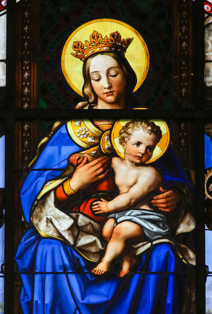 infant jesus: GHENT, BELGIUM - DECEMBER 23, 2016: Stained Glass (1851) in Saint Nicholas Church, Ghent, depicting Mother Mary and the Infant Jesus, Madonna and Child. Editorial